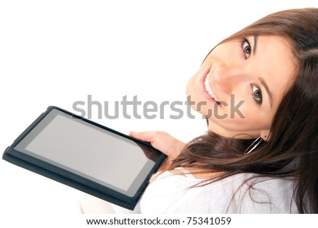 Pretty brunette woman holding in hand new electronic tablet touch pad computer pc digital screen and smiling, looking at the camera on a white background