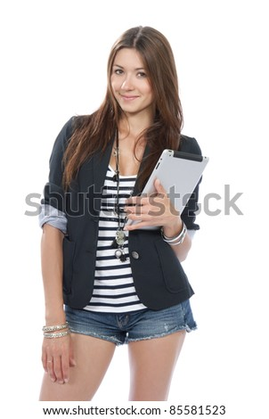 Pretty brunette woman holding in hand new electronic tablet touch pad computer pc digital screen and smiling, looking at the camera on a white background - stock photo