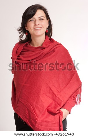 Pretty brunette wrapped in a cashmere red shawl