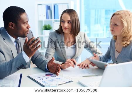 Pretty business interns listening to their team leader