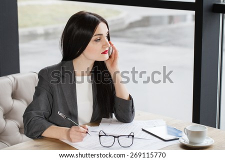 Pretty business lady having a conversation with a client concern