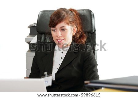 """Pretty business lady or student with a badge """"Boss""""  working with a laptop"""