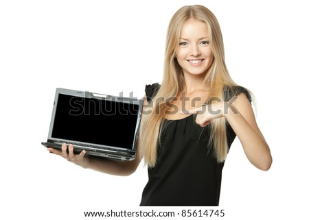 Pretty business woman pointing at notebook laptop screen with copy space over white background - stock photo