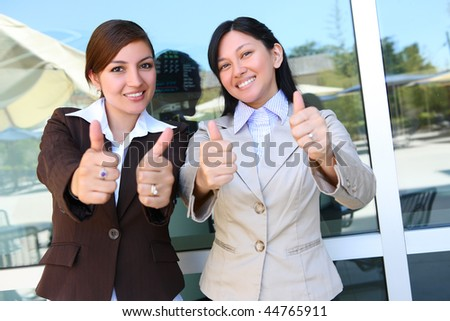 Pretty Business Woman Team at Office Building with Thumbs Up