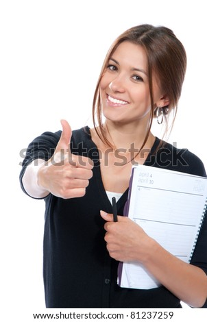 Pretty business woman thumb up, smiling, holding notepad, copy-book and a pen in office on a white background