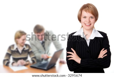 Pretty businesswoman and business team over white background