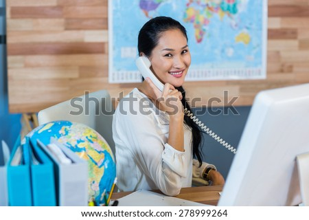 Pretty businesswoman having phone call in the office