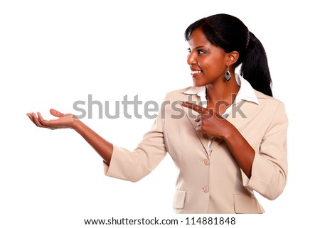 Pretty businesswoman looking and pointing right on isolated background