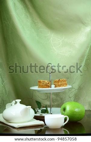 pretty cake stand with elegant china tea set