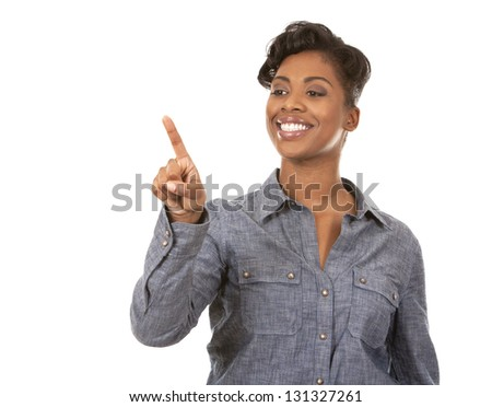 pretty casual black woman pointing with her arm on white background