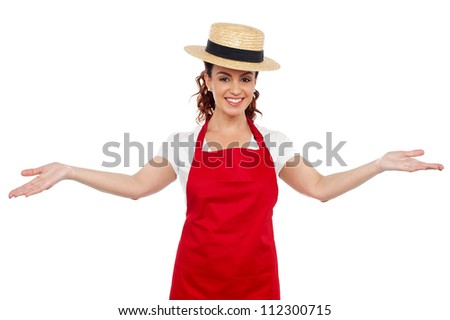 Pretty chef welcoming you with her arms stretched isolated over white background