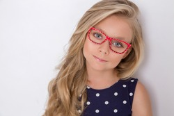 Pretty child girl wearing glasses isolated on white  background. Eyewear concept.
