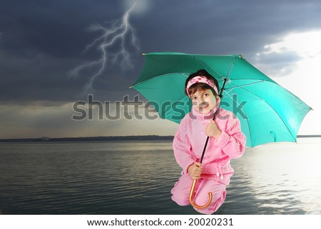 Pretty child sit under umbrella
