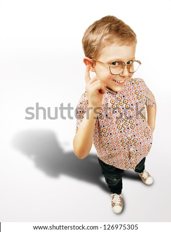 Pretty clever boy portrait with big shadow on white background