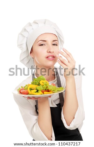 Pretty cook chief holding salad - stock photo