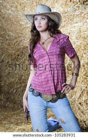 Pretty country cowgirl in hay
