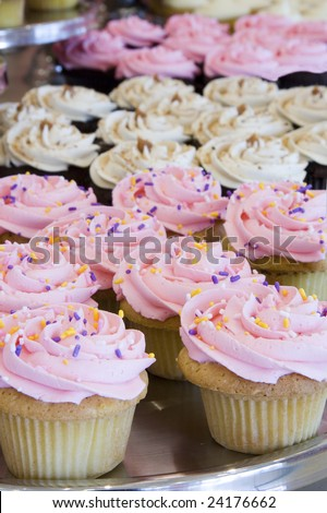 stock photo Pretty cupcakes with sprinkles Shallow dof focus on the