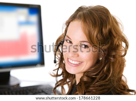 Pretty Customer Service Representative with Headset and Monitor in Background
