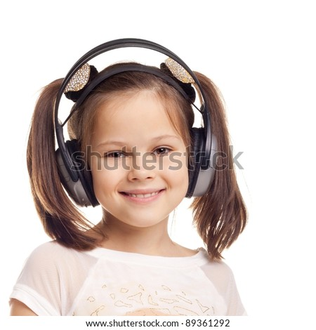 pretty cute little girl wearing the headphones