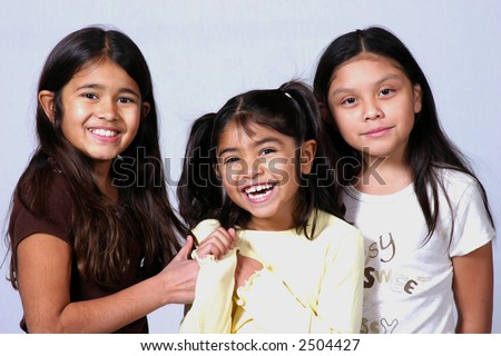 Pretty dark haired girls laughing and having fun - stock photo