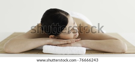 Pretty dark-haired woman getting a spa treatment lying down