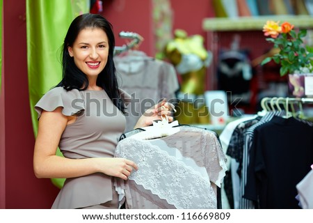 pretty elegant woman in clothing store