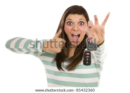 Pretty Ethnic Female with New Car Keys and Thumbs Up Isolated on a White Background.
