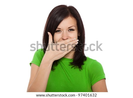 pretty excited woman happy smile cover her mouth by hand palm, young attractive girl wear green shirt, isolated over white background
