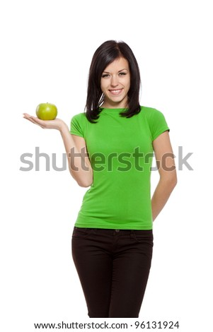 pretty excited woman happy smile hold green fresh apple in hand, young attractive girl wear green shirt, isolated over white background
