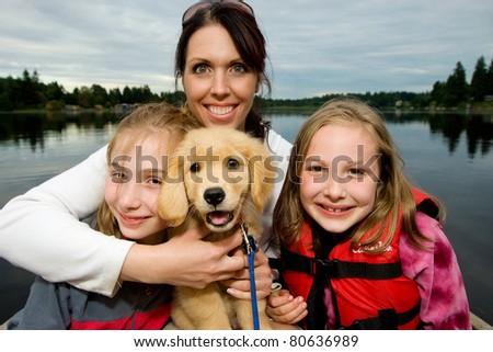 pretty family at a lake