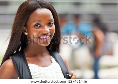 pretty female african american high school student on campus
