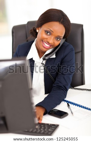 pretty female african corporate worker working in office