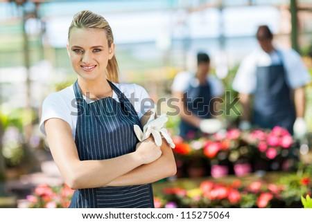 pretty female florist portrait in greenhouse