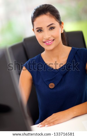 pretty female office worker by her work station