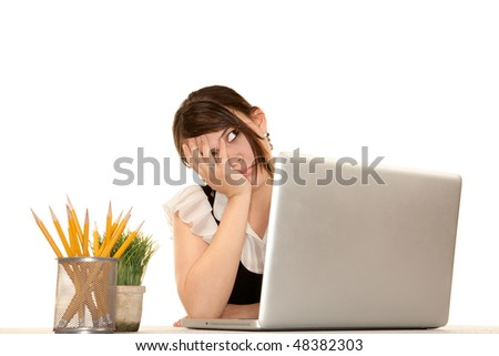 Pretty female office worker with laptop computer