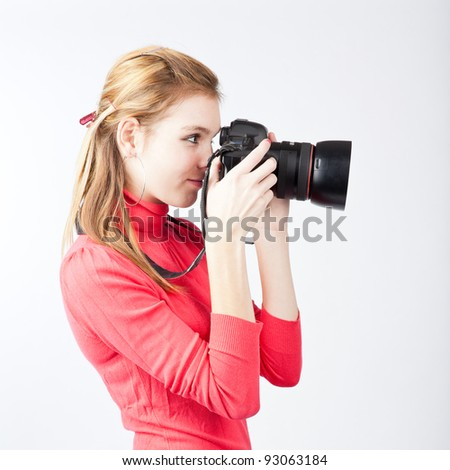 pretty, female photographer with her digital camera (color toned image; shallow DOF)