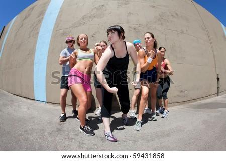 """Pretty female runner poses for her """"me"""" shot."""