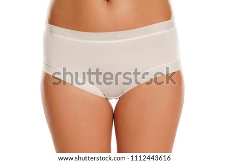 pretty feminine hips and white panties on white background