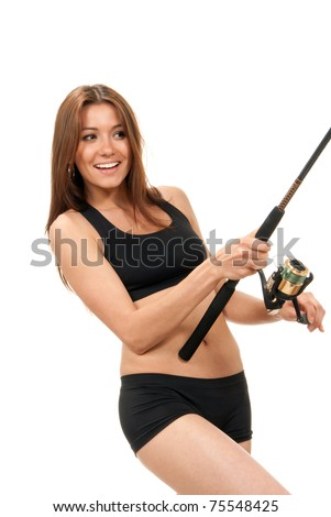 Pretty fisher woman standing, holding fishing pole with a reel in hands, catching fish, smiling on a white background