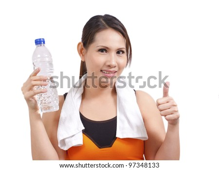 pretty fitness woman holding a bottle with good sign