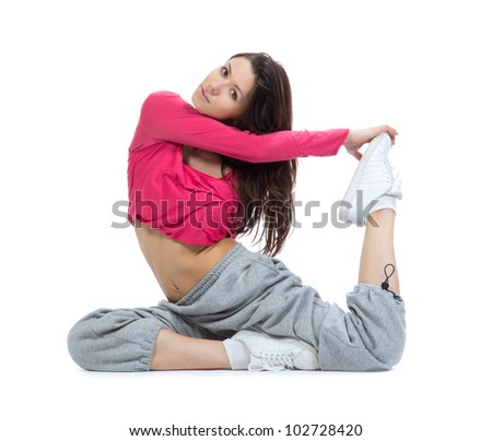Pretty flexible dancer woman doing stretching exercise on a white background