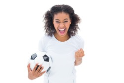 Pretty football fan in white cheering at camera on white background