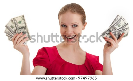 pretty funny young woman in a red blouse holds the money, American dollars isolated on a white background