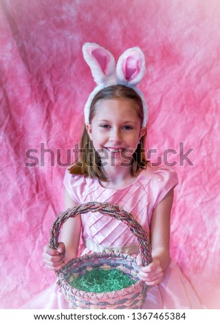 pretty gir with easter basket and bunny ears