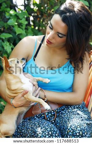 pretty girl and dog eye to eye