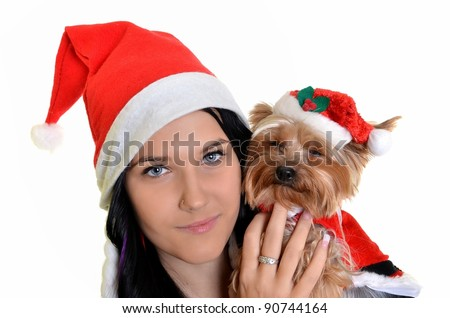 pretty girl and dog in santa hat at Christmas - stock photo