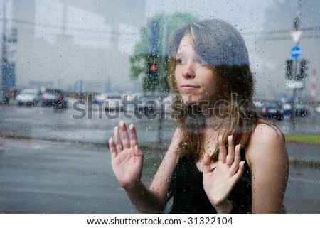 pretty girl at the bus station waiting when rain is over