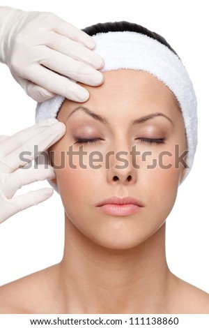 Pretty girl decides to try a plastic surgery to be more perfect, isolated, white background