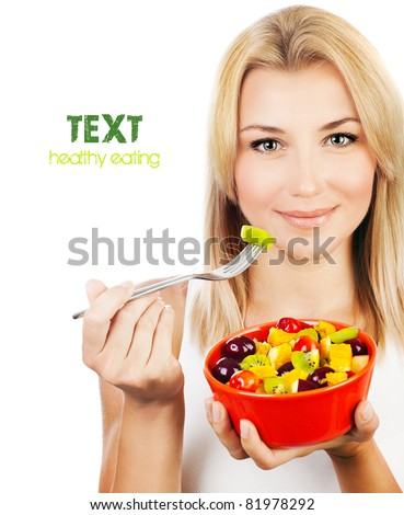 Pretty girl eating fruit salad, healthy fresh breakfast, dieting and health care concept