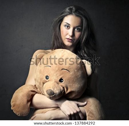 pretty girl embraces big teddy bear
